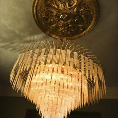 A mammoth chandelier is an important prop at the end of Act One of