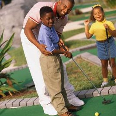Playing miniature golf is one way for boys to celebrate birthdays in Gainesville, Florida.