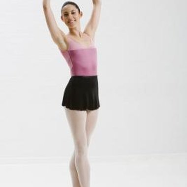 A ballet dancer stands on pointe.