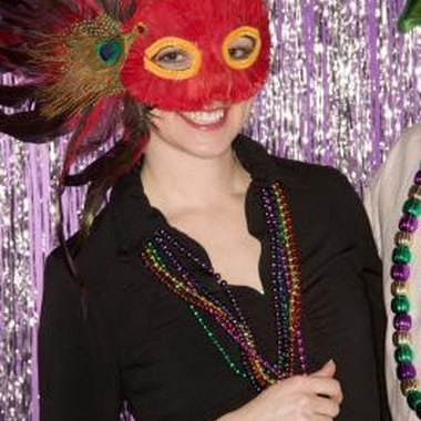 Organize a masquerade party for your teen so she and her guests can wear colorful masks.
