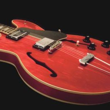 Semi-hollow body guitars, like the one shown here, often have holes on the top called
