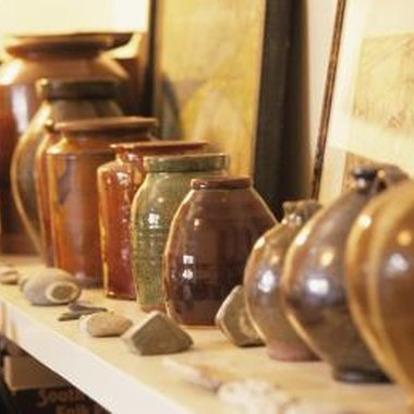 Display the pottery at different heights.