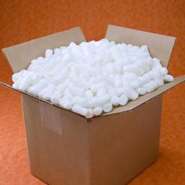 Turn packing peanuts into tiny sailboats by using a toothpick and paper.