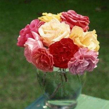 Simple bouquets of roses, whether multicolor or in one color, can add an elegant look to any wedding shower table.