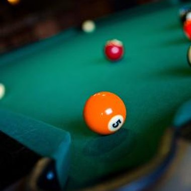 It takes practice and skill to excel at billiards.