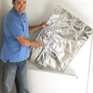 Mold aluminum foil around a cardboard cutout to create a crown.