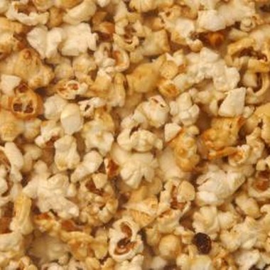 Popcorn is an inexpensive treat that can double as movie-themed party decorations.