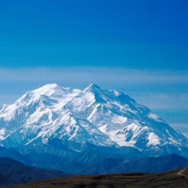 The highest peak in North America, 20,320-foot Denali, can dominate views in both the national and state parks named for it.