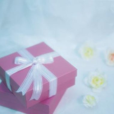 Wrap your baby shower favors in colorful favor boxes.