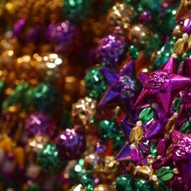 Purple, green and gold beads are thrown from floats during Mardi Gras parades.