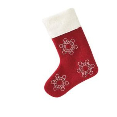 Decorate the white cuff of a Christmas stocking with an embroidered name.