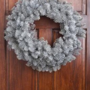 Decorate existing wreaths with baby supplies.