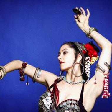 Finger cymbals add an auditory element to belly dance.
