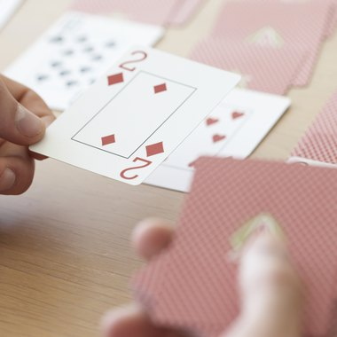 Begin Solitaire by dealing 28 cards from the deck.