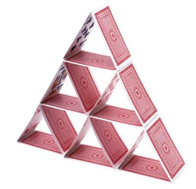 Students can find directions for building a triangle with playing cards on the Internet.