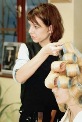 You need to consider cost and reputation when choosing a cosmetology school.