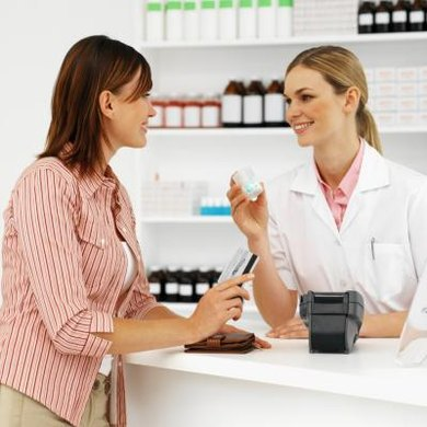 Pharmacists dispense medication to consumers.