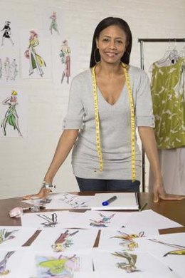 Fashion designers sketch designs and select fabrics and patterns for clothing and accessories.