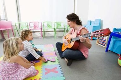 a Sunday School teacher sings Easter songs with preschoolers.