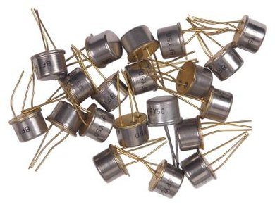 Early transistors were a fraction of the size of the vacuum tubes they replaced.