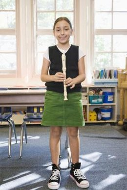 Use recorders to encourage fifth graders to learn to play an instrument.