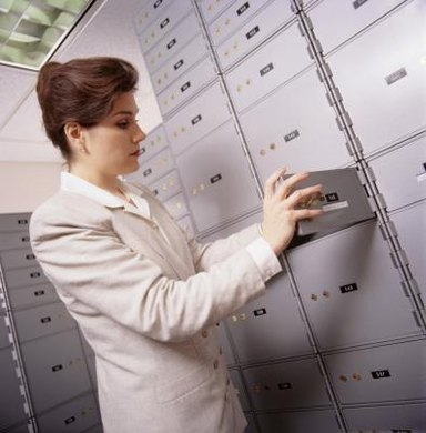 Safe deposit boxes are stored inside bank vaults.