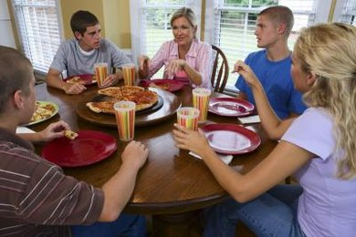 Plan family dinners to help your teenager eat less.