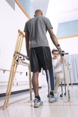 Physical therapist assistants help injured patients walk.