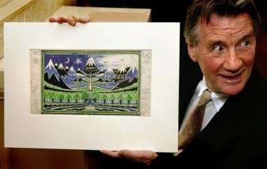 Michael Palin holds the original artwork for the cover of 'The Hobbit.'