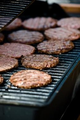 A mid-sized grill can fit 16 to 30 hamburgers at a time.
