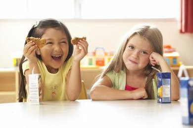 Young children can learn to divide by sharing snacks equally.