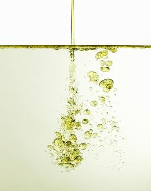 Oil and water do not mix because the energegtic threshold for mixing is prohibitive.