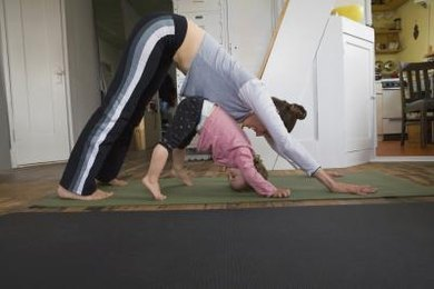 Downward facing dog helps stretch the legs and elongate the back.
