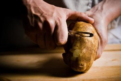 Potatoes can be peeled a day ahead, but they'll brown if they're not submerged in water.