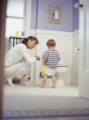 Teaching a boy to urinate standing up makes preschool eaiser.