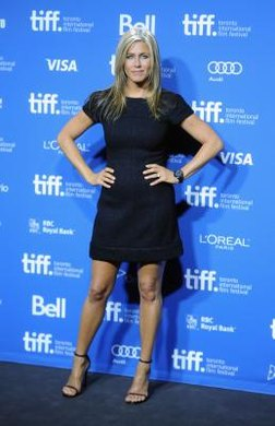 Actress Jennifer Aniston wears a navy dress with simple black sandals at the 2013 Toronto International Film Festival.