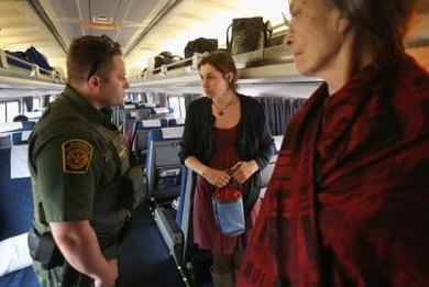 U.S. border patrol agents are charged with inspecting travelers' passports.
