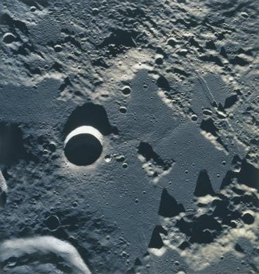 The surface of the moon, shown here, is similar in appearance and composition to the planet Mercury.