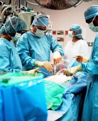 Surgery technologists often hand instruments to surgeons during procedures.