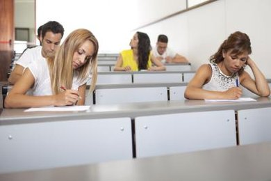 Students taking notes in college course