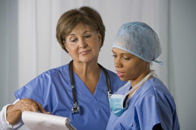 A nurse is chatting with a doctor.