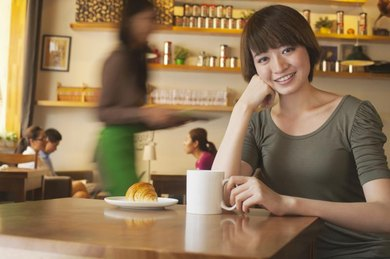 A Japanese woman is smiling at the camera.