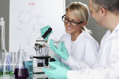 Biochemistry student working in laboratory with professor.