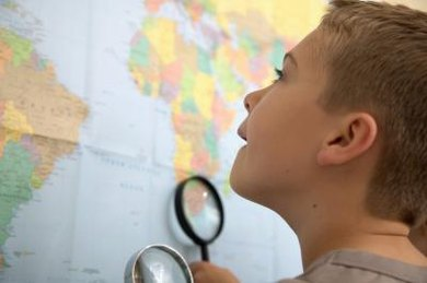 young boy looking at map