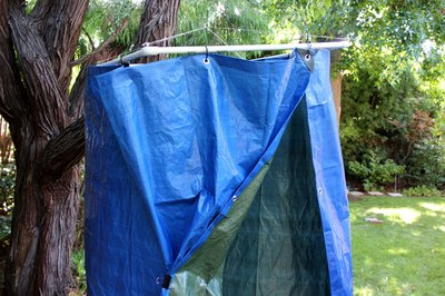 Hang the tarp on the PVC pipe