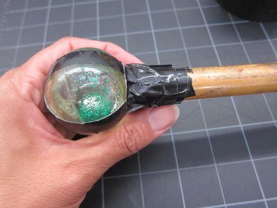 Attach bouncy ball to bamboo rod.