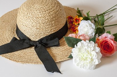 Start with a straw hat that has a wide brim
