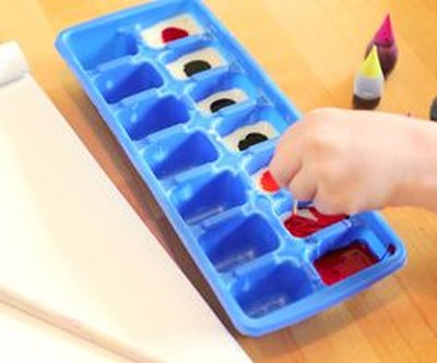 Mix food coloring with condensed milk to create the edible paint colors.