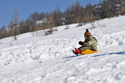 Sit feet-first when sledding.