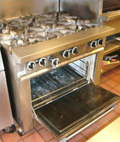 Cooktop unit with six-burner range and standard oven below